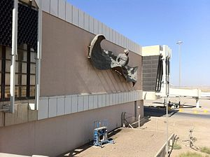 Baghdad International Airport - A flying carpet sculpture on the wall at BIAP. (2011)
