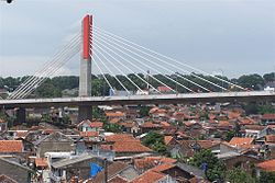 The Pasupati Bridge on top of resident houses.