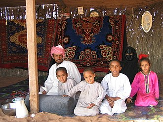 A Bedouin family in Wahiba Sands, Oman. Bedouin family-Wahiba Sands.jpg