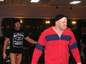 "Mike Kanellis - Bennett (left) with his manager and trainer ""Brutal"" Bob Evans in October 2011"