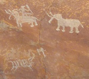 Indian art - Rock painting at one of the Bhimbetka rock shelters