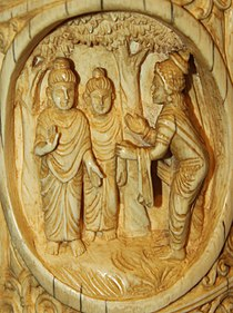 Bimbisar welcoming Buddha Roundel 30 buddha ivory tusk.jpg