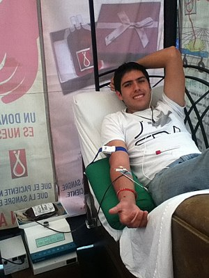Blood donation - A college student in a campaign of blood donation.