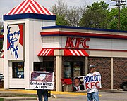 Protesters demonstrating outside a KFC restaurant in Royal Oak, Michigan