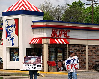 Boycott - Protesters advocating boycott of KFC due to animal welfare concerns