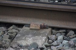 Broken Pandrol clip at Bromborough railway station (26872782811).jpg