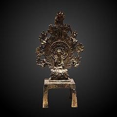 Buddha assis esquissant le geste de l'apaisement.