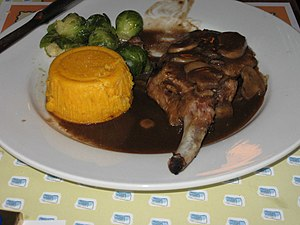 Demi-glace - A pork chop with brussels sprouts, a sweet potato puree, and a mushroom demi-glace