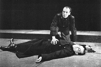 George Coulouris - Antony (George Coulouris) kneels over the body of Brutus (Orson Welles) at the conclusion of the Mercury Theatre production of Caesar (1937–38)