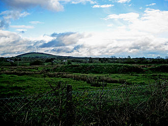 Carn Clonhugh - Cairn Hill can be seen in the distance, with a ringfort in the foreground
