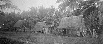 Wa (watercraft) - Image: Caroline Islanders Village near Agana, Guam (1899 1900)