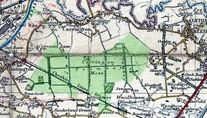 Carrington Moss - A 1937 map of Carrington Moss, with the boundary of the Carrington Moss Estate overlaid in green.  The tramway network is clearly visible, including the connection to the Manchester Ship Canal.