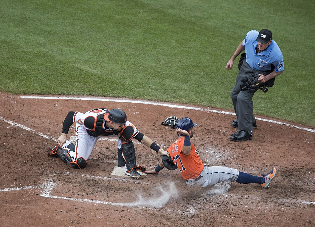 Catcher Caleb Joseph, José Altuve out at home plate, umpire Mike Winters (2)