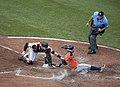 Catcher Caleb Joseph, José Altuve out at home plate, umpire Mike Winters (2).jpg