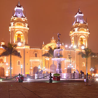Historic Centre of Lima - Night view of the Cathedral of Lima, which is illuminated. In the foreground is the Renaissance pool of the Viceroy Count of Salvatierra..