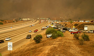Cedar Fire (2003) - Drivers scramble up the embankment to escape from Interstate 15, as the Cedar Fire crosses the freeway