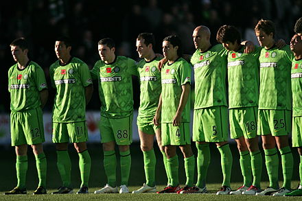 Football clubs commonly wear jerseys with a poppy emblazoned on, as Celtic controversially did in 2010. Celtic team - November 2010.jpg