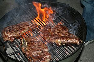 Char-grilled steak - Chuck steaks cooked over an open-top charcoal grill using charcoal briquettes.