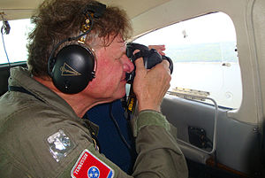 Tennessee Wing Civil Air Patrol - Charlie Smith, an ATA senior engineer and mission pilot for the Civil Air Patrol, lines up a photo out of the rear-seat swing window during an oil spill surveillance mission.