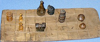 "Fairy chess piece - Fragment of a chessboard and chess pieces from the 17th century. This may once have been a ""standard"" form of chess in a particular area."