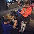 Child putting on hockey equipment (21315231649).jpg
