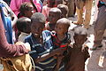 Children queue for food at a aid distribution centre in Mogadishu, Somalia, August 2011 (6195801984).jpg