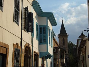 Old town - Traditional houses with the Roman Catholic Church of the Holy Cross in the background, walled city of Nicosia.