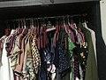 Clothes hanged inside a closet.jpg
