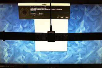 Color calibration - Color calibration of a monitor using ColorHug2, an open source colorimeter, placed on the screen.