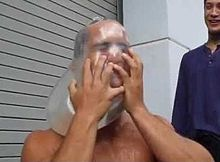 A Man Taking The Condom Challenge