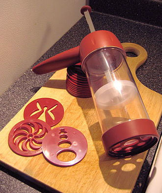 Cookie press - A cookie press with different plates.