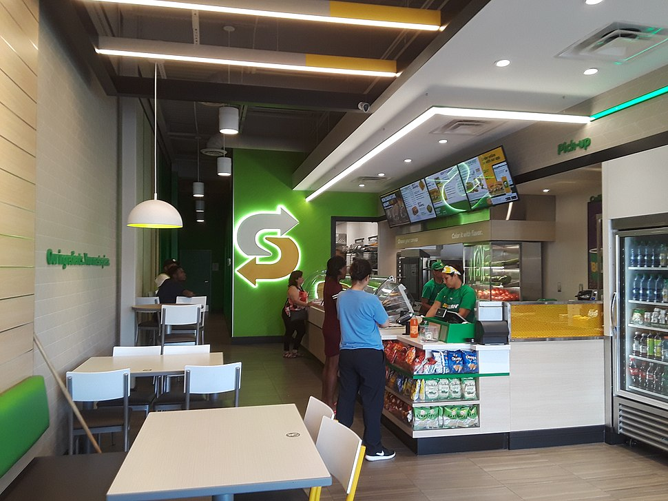 Counter and customers, new-style Subway restaurant