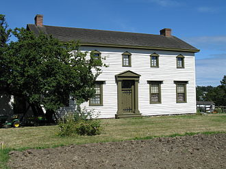 Craigflower Manor and Schoolhouse - Craigflower manor, as seen from the front. A fallow field is visible in the foreground.