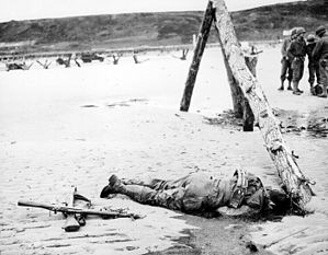 Crossed rifles in the sand.jpg