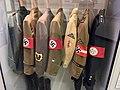 Deutsches Historisches Museum 2019-10-13 lowres Nazi Germany uniform jackets tunics badges swastika arm bands Staatsforstdienst NS-Ordensburgen diplomatic corps NSKK BDM HJ DAF 3890.jpg