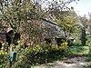 foto van Boerderij waarvan het woonhuis met de stal een T-vormige plattegrond uitmaakt