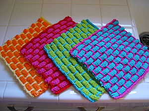 Dishcloth - Dishcloths are typically square, and are usually made of cotton or other cloths.