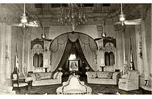 Wasif Manzil - An old photo of the palace's drawing room with Nawab Wasif Ali Mirza Khan picture at the back.