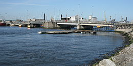 Tom Clarke bridge from the south bank of the Liffey looking downstream
