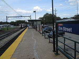 Elm Street station - The Elm Street station seen from the lone platform in September 2013. The yard at Elm Street is visible in the distance.