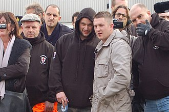English Defence League - Tommy Robinson (centre-right, in the light coloured jacket) with other EDL members on a visit to Amsterdam