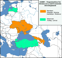 Locations of GUAM member states (orange) and observers (green) in Eastern Europe and the Caucasus.