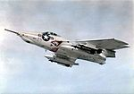 F8F-8 Cougar with Sidewinder missiles in flight 1958.jpg