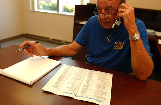 FEMA - 33005 - SBA representative on the phone making calls in Ohio