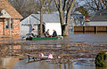 FEMA - 34579 - People evacuating their flooded home in Missouri by boat.jpg