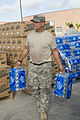 FEMA - 37339 - Army National Guard holds water at a food distribution site in Texas.jpg