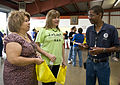 FEMA - 37550 - FEMA public affairs specialist talks to residents in Texas.jpg