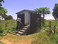 Family toilet with bath shelter (7825733280).jpg