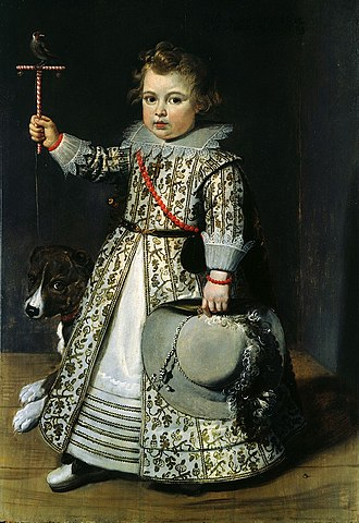 Breeching (boys) - Flemish boy of 1625 in a dress with sewn in tucks to both layers of the skirt to allow for growth. The hair and hat are distinctively masculine, and he wears a sword or dagger (observer's left) and red coral beads, which were used for teething.