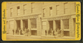 Foster, Weeks & Co. grocery, showing men with boxes out front, by Leander Baker.png